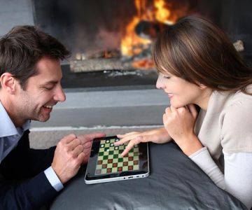 A couple playing game in tab