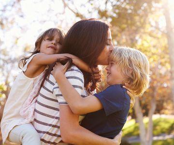 A girl hug there kids